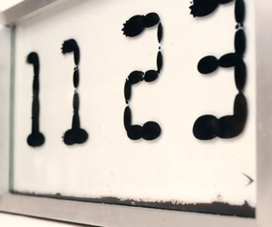 Ferrolic, The Liquid Clock