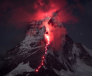 hundreds climbed the alps for epic photoshoot