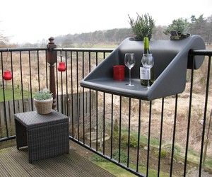 Balcony Table Makes Good Use Out of a Small Space