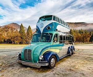 Randy Grubb welds a VW bus on a camper