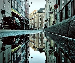 Urban Cityscapes reflected in Puddles